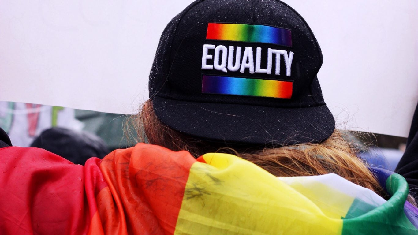 Back of head of someone wearing a Pride Equality baseball cap