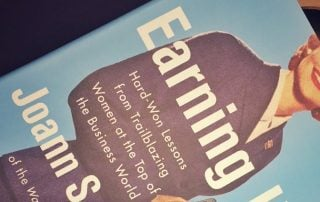 "Close up of Joann Lublin's book ""Earning It"""