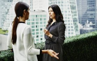 Two women conversing outdoors