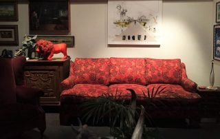 Room with red floral couch
