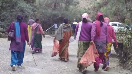 Group of East Asian women picking up trash outdoors