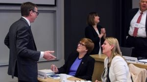 Discussion between three attendees at the Industry Partner Workshop   February 2018