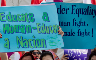 Women protest holding signs for education and gender equity