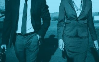 A mid shot of a man and woman in a suit walking