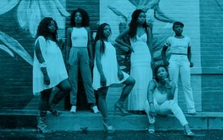 Six confident black women pose