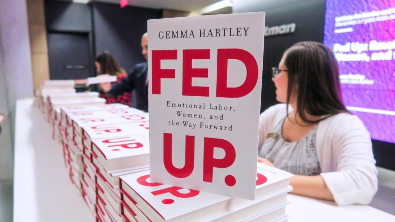 """Cover of book """"Fed Up"""" stacked on event registration table"""