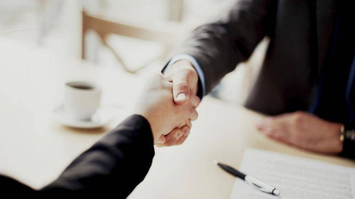 Hand shaking over a business deal