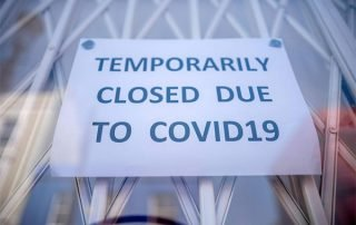 "Window sign reading ""TEMPORARILY CLOSED DU TO COVID19"""