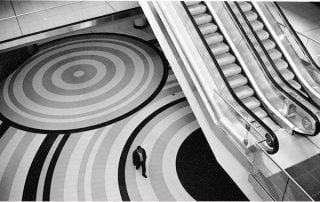 Aerial shot of escalators with single person walking by