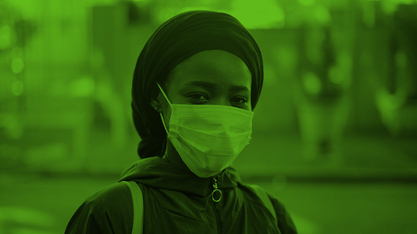 Closeup of woman wearing mask