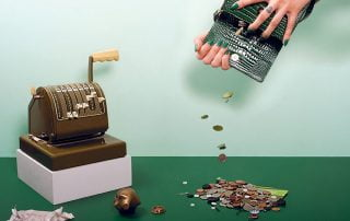 Hands opening purse and emptying contents